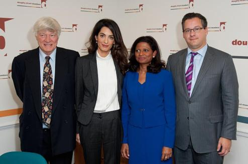 LONDON, ENGLAND - OCTOBER 05: (L-R) Geoffrey Robertson QC, Amal Clooney, Laila Ali and Jared Genser attend a press conference regarding the detention of Mohamed Nasheed, President of the Maldives at Doughty Street Chambers on October 5, 2015 in London, England. Clooney is part of an international legal team seeking to release Maldivian President Mohamed Nasheed after he was was jailed for 13 years. The UN have found Nasheed's detention in violation of international Law. (Photo by Eamonn M. McCormack/Getty Images)