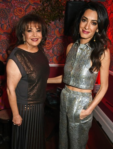 LONDON, ENGLAND - DECEMBER 03: Amal Clooney (R) and mother Baria Alamuddin attend Charlotte Tilbury's naughty Christmas party celebrating the launch of Charlotte's new flagship beauty boutique in Covent Garden on December 3, 2015 in London, England. (Photo by David M. Benett/Dave Benett/Getty Images for Charlotte Tilbury)