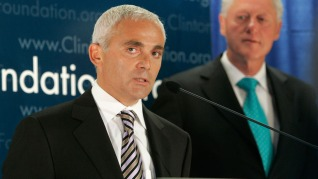 Frank Giustra, a Canadian businessman, speaks as former President Bill Clinton looks on during a news conference to announce the Clinton Foundation's launching of a new sustainable development initiative in Latin America Thursday, June 21, 2007 in New York. Giustra has pledged $100 million to the Clinton Giustra Sustainable Growth Initiative as well as half of all of his future earnings from his work in the natural resources sector. (AP Photo/Frank Franklin II)