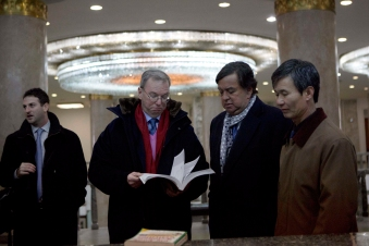"Executive Chairman of Google, Eric Schmidt, second from left, and former Governor of New Mexico Bill Richardson, second from right, look through an information technology text book at the Grand People's Study House in Pyongyang, North Korea on Wednesday, Jan. 9, 2013. At left is director of Google Ideas think tank, Jared Cohen. The textbook is titled ""Aries Net+ Certified Technician First Edition Version 3.0. "" (AP Photo/David Guttenfelder)"
